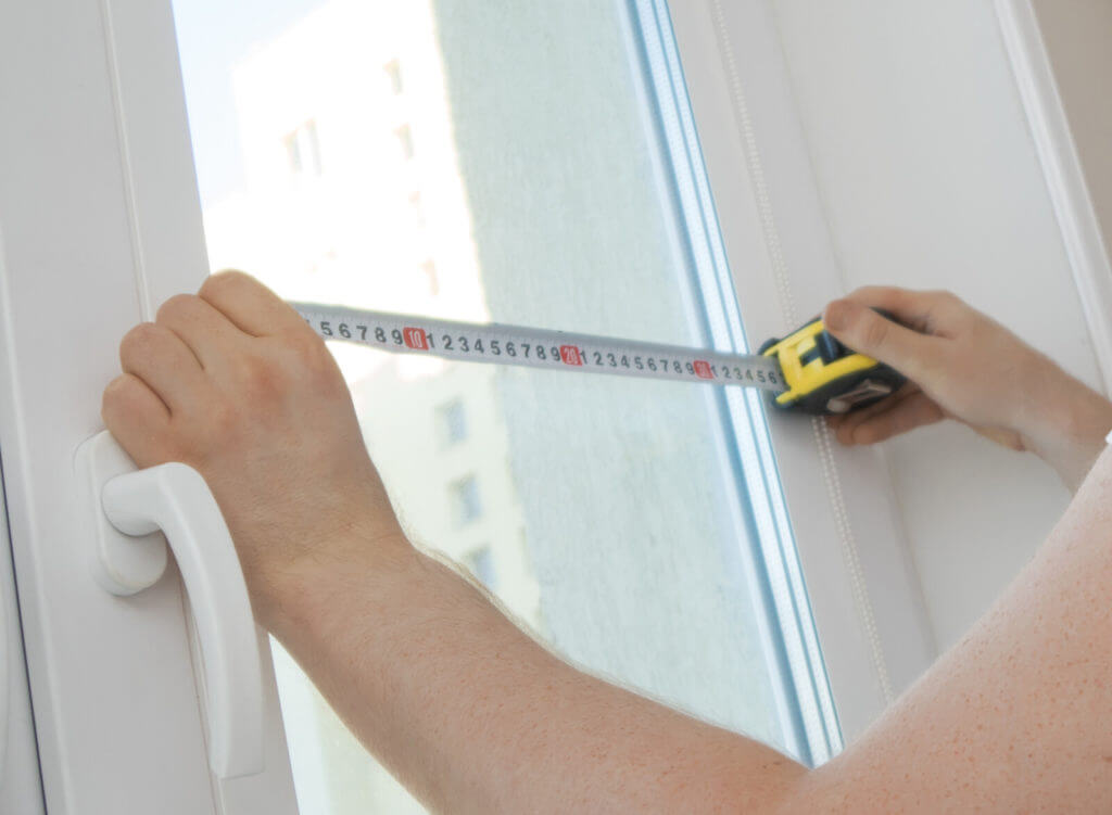 professional window installation technician on-site measurements